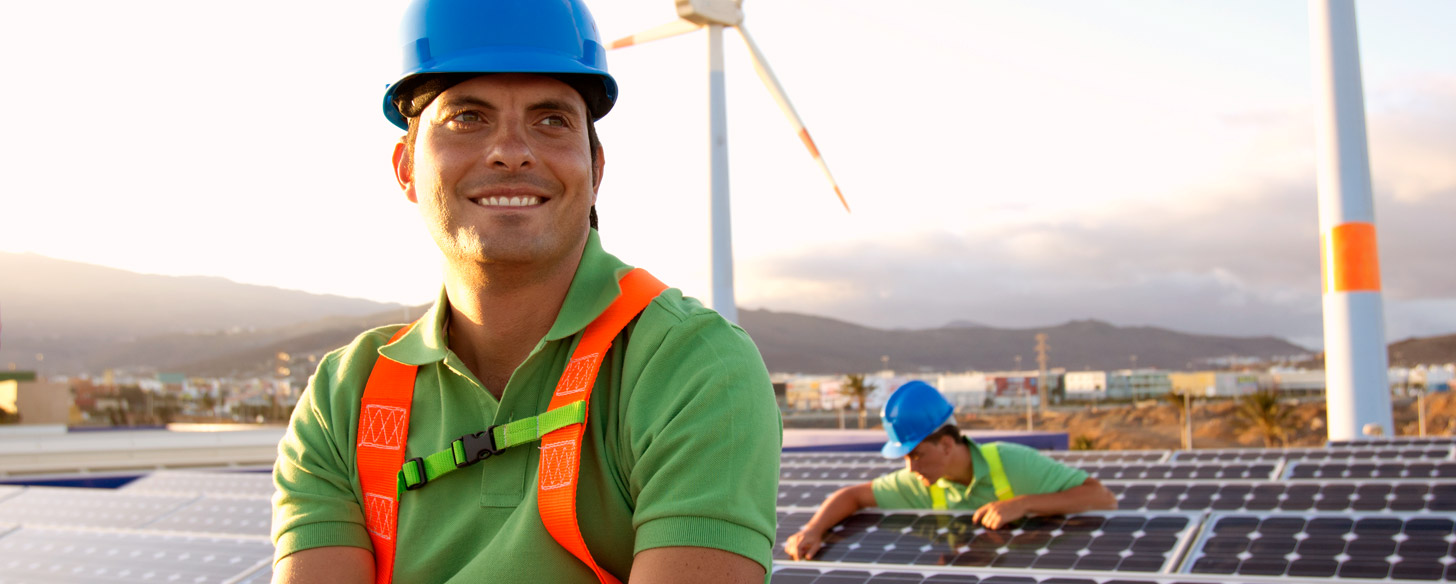Image of man near a solar farm